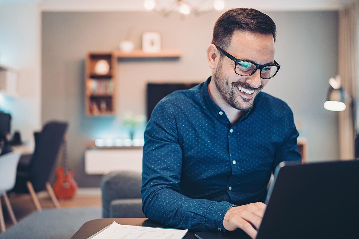 man accessing laptop